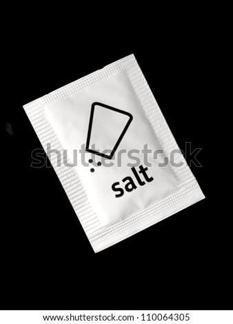 One package salt on black background
