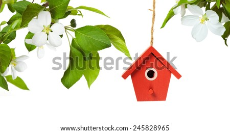 one painted birdhouse with...