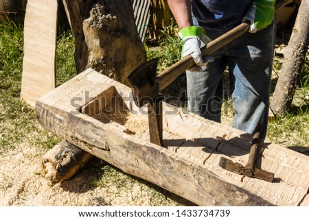 one part of making a wooden fountain is to remove the wooden blocks with a wedge and a splitting axe