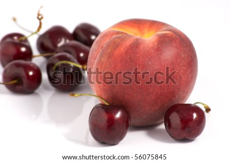 One peach and a cherries group on white background