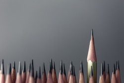 One pencil standing out from the group of other pencil.Leadership and growth in business concept.