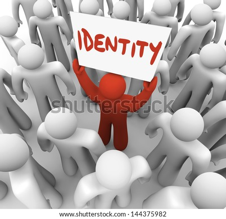 One person holds a sign or banner with the word Identity to spread awareness of his unique brand, quality, integrity or reputation to his audience or customers ストックフォト ©
