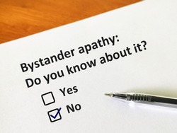 One person is answering question about bystander apathy.  The person is thinking if he knows about it.