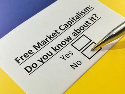 One person is answering question about free market capitalism.