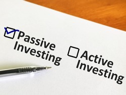 One person is answering question about investment. The person is thinking to do active or passive investment. The person chooses passive investing.