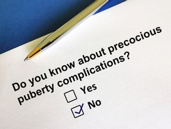 One person is answering question about precocious puberty complication.  The person is thinking if he knows about it.