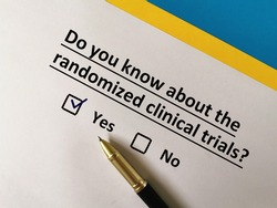 One person is answering question about vaccines. He knows about the randomized clinical trials.