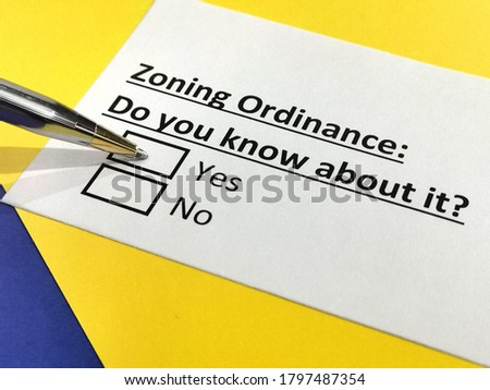 One person is answering question about zoning ordinance. Stock photo ©