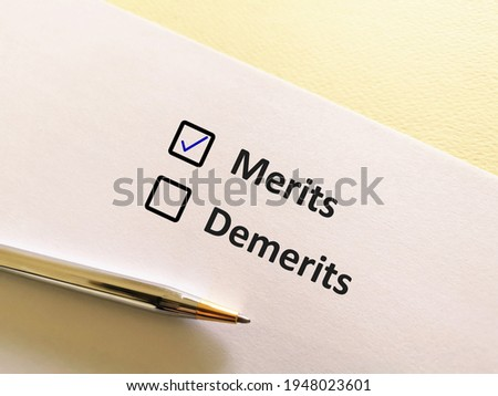 One person is answering question. He chooses merits over demerits. Stockfoto ©