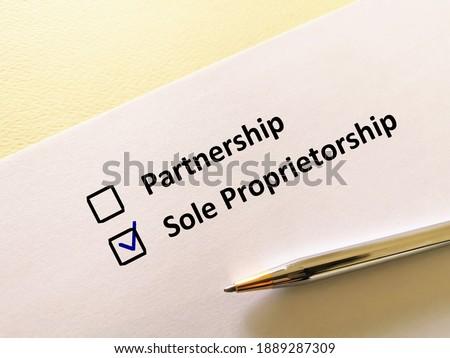 One person is answering question. He chooses sole proprietorship. Foto d'archivio ©
