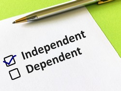 One person is answering question. He is choosing between independent or dependent.