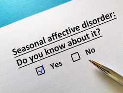 One person is answering question. He knows about seasonal affective disorder.