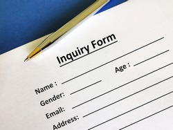 One person is filling up inquiry form.