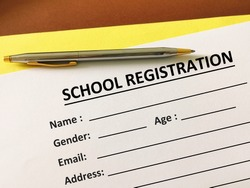 One person is filling up school registration.