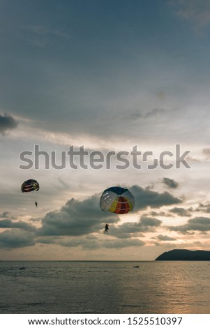 one person parachuting over ocean in Malaysia