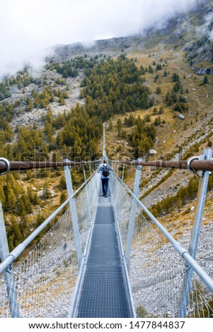 one person walking on Charles Kuonen Suspension Bridge longest pedestrian bridge in the world