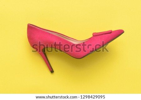 003adadf3a7 One pink high heels isolated-yellow background