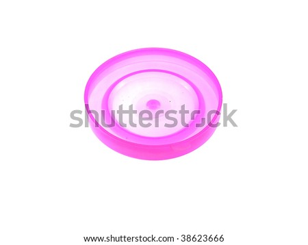 One pink plastic cap on bank isolated on a white background