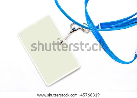 One plastic name tag on a blue lanyard.  Background is white with copy space on name tag as well as on the background.