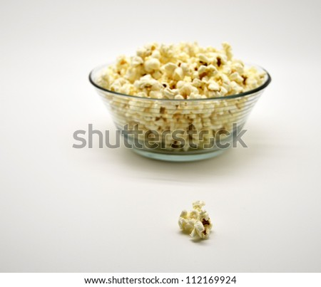 one popcorn outside the glass bowl