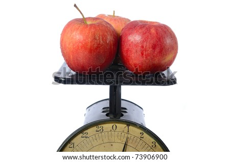 One pound of red apples on an old vintage scale.