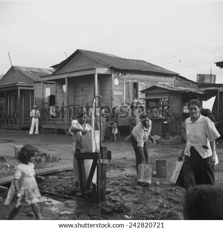 One pump is the community water supply in the workers\' quarter of Porta de Tierra, part of San Juan, Puerto Rico. January 1938 photo by Edwin Rosskam.
