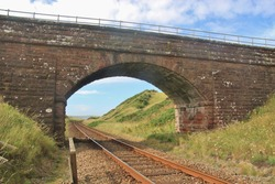 One rail railway and railway bridge along the north-western coast of England, near Sellafield. It is one of the oldest railways in England, opened in 1845. North-west Europe.