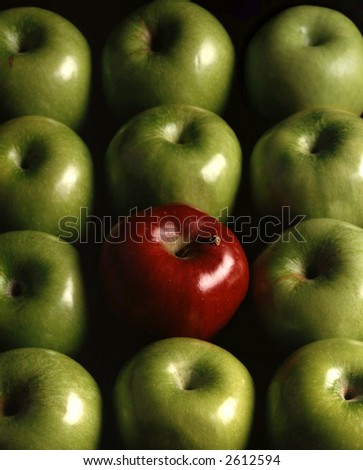 One red apple among the green apples