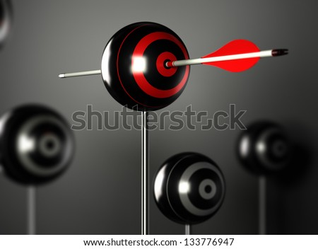 one red arrow hitting the center of a ball target with other blur targets around, black background with light effect - stock photo