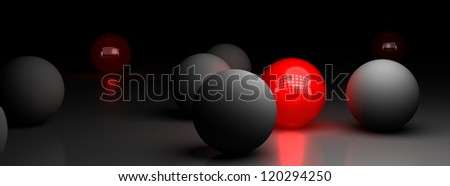 one red ball illuminating many grey spheres over a black background, symbol of difference