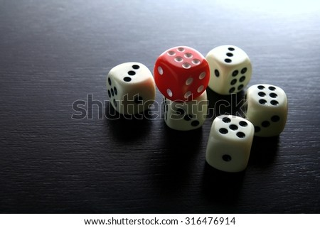 One Red game dice and five white game dice