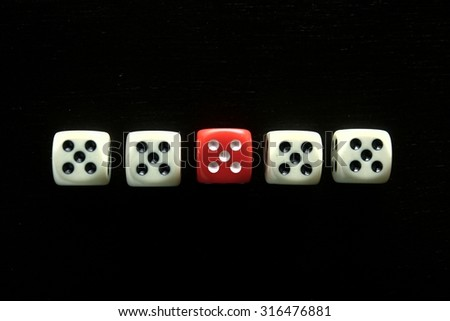 One Red game dice and four white game dice