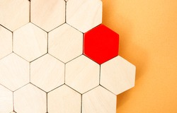 One red hexagon stands out from the rest. Leadership and victory concept. Dissimilarity and dissent. Uniqueness initiative. Superfluous, unsuitable. Going beyond. Untypical Concept