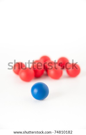 One Red Sphere with Lots of Red Ones Leadership Concept