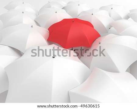 One red umbrella among set of other white