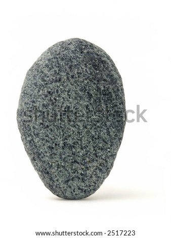 One rock carefully balanced on its end, isolated on white background.
