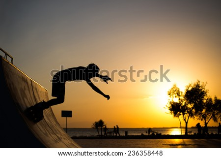 One roller skater skating on a skate at sunset time. At Bostanli Izmir Turkey May 23 2014 #236358448