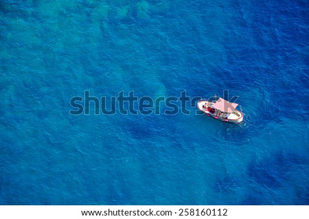 One romantic alone boat in blue sea, bird\'s eyes view, Capri island, Italy
