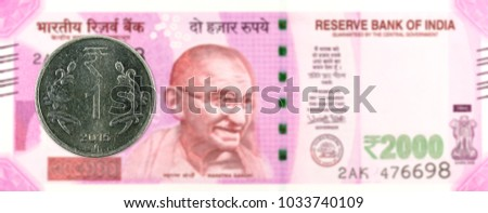 one rupee coin (2015) against 2000 indian rupee bank note obverse #1033740109