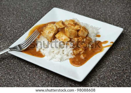 one serving of a spicy chicken tikka marsala over basmati rice
