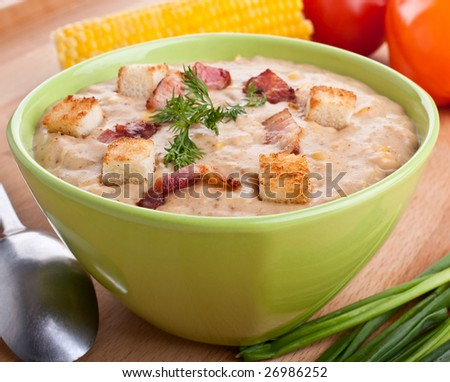 one serving of corn cream soup puree on wooden table