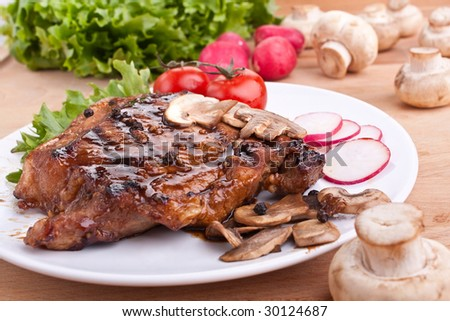 one serving of pork chop with mushrooms and radish