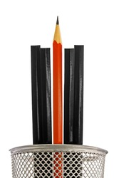 One sharp red pencil in a modern metal pot with four un-sharpened black ones against a white background. Illustrates standing out from the crowd, being the best.