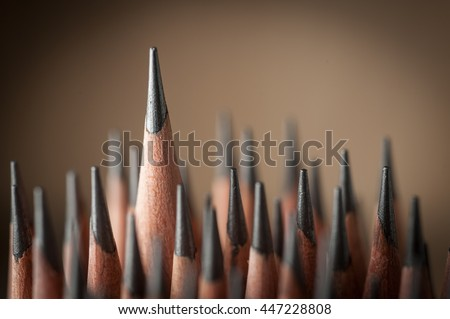 One sharpened pencil standing out from the other  pencil