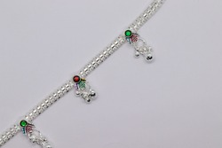 one silver leg chain and blue stone with Anklets for design on white background (anklet)