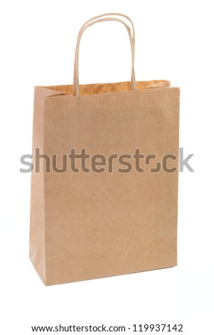 One simple brown paper shopping bag isolated on white background