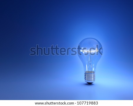 One simple glowing light bulb isolated on blue background