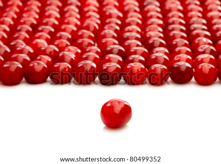One single cherry and group of cherries over white