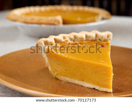 one slice of pumpkin pie cut from the whole