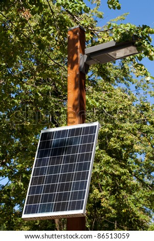 One small solar battery, which provides electricity not only for lamp, but for sockets on post's base.